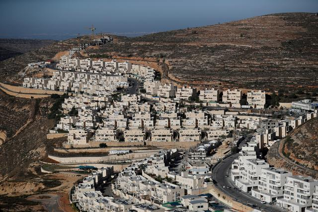 FILE PHOTO: A general view shows construction of the Israeli settlement of Ramat Givat Zeev in the occupied-West Bank November 19, 2019. REUTERS/Ammar Awad/File Photo