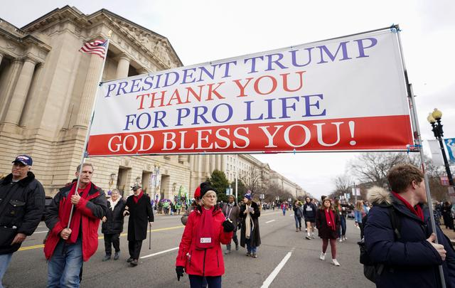 Anti-abortion activists march with banner thanking U.S. President Donald Trump for his support during the 47th annual March for Life in Washington, U.S., January 24, 2020. REUTERS/Kevin Lamarque