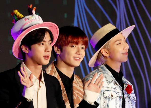 FILE PHOTO: Jin, Jungkook, RM members of South Korean boy band BTS pose on the red carpet during the annual MAMA Awards at Nagoya Dome in Nagoya, Japan, December 4, 2019. REUTERS/Kim Kyung-Hoon