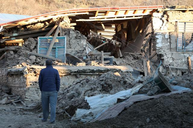 A villager looks at his collapsed house after an earthquake in Sivrice near Elazig, Turkey, January 25, 2020. REUTERS/Sertac Kayar