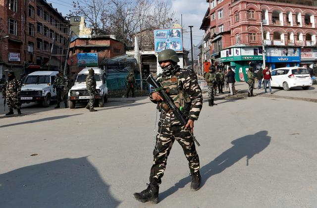 FILE PHOTO: Indian security forces personnel patrol a street in Srinagar January 10, 2020. REUTERS/Danish Ismail