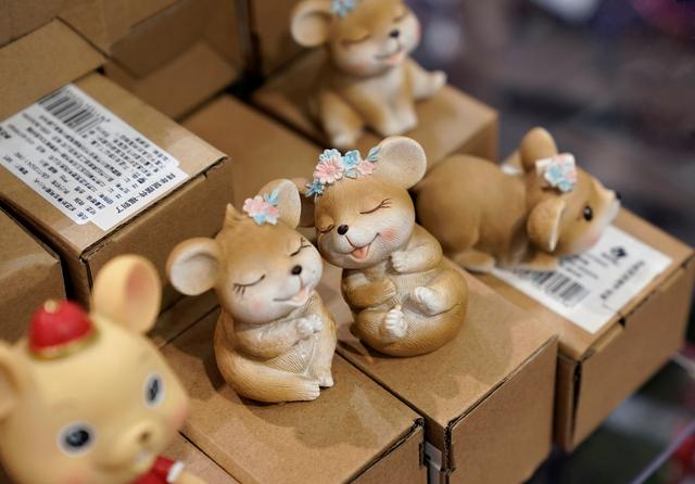 FILE PHOTO: Lunar New Year of the Rat decorations are displayed for sale at a shopping mall in Beijing, China December 31, 2019. REUTERS/Jason Lee