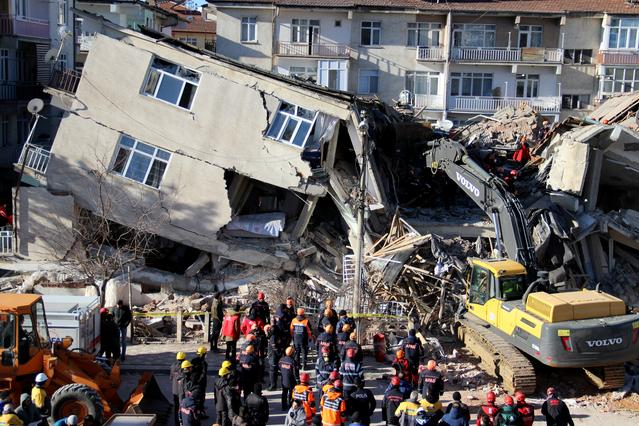Rescuers work on collapsed buildings after an earthquake in Elazig, Turkey, January 25, 2020. Ismail Coskun/Ihlas News Agency (IHA) via REUTERS