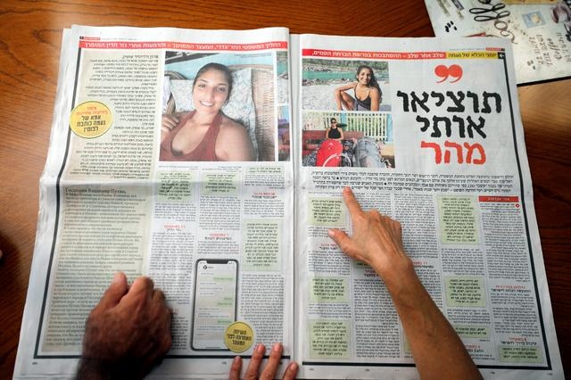 FILE PHOTO: Israel, the uncle of Naama Issachar, and his wife look at a newspaper with an article about Naama at their home in Rehovot, Israel October 13, 2019. REUTERS/Amir Cohen