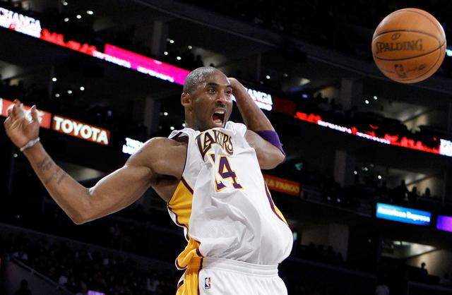 FILE PHOTO: Los Angeles Lakers Kobe Bryant celebrates after dunking against the New York Knicks during their NBA basketball game in Los Angeles, California, January 9, 2011.  REUTERS/Lucy Nicholson/File Photo