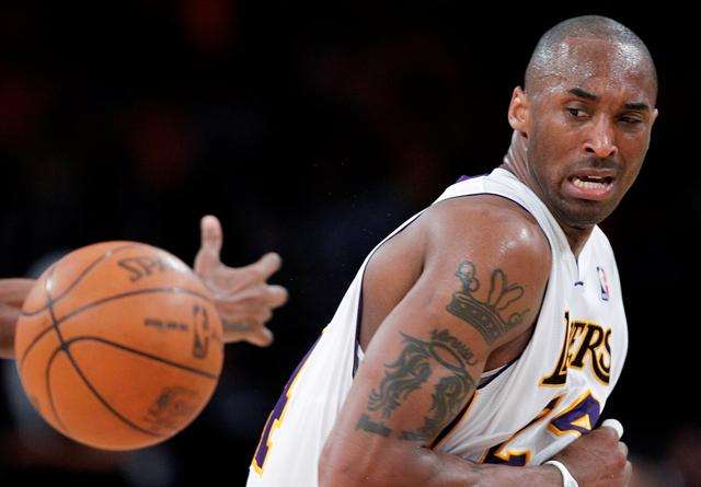 FILE PHOTO: Los Angeles Lakers' Kobe Bryant loses control of the ball during Game 1 of their NBA Western Conference first round playoff basketball game against the New Orleans Hornets in Los Angeles, California April 17, 2011.  REUTERS/Lucy Nicholson/File Photo