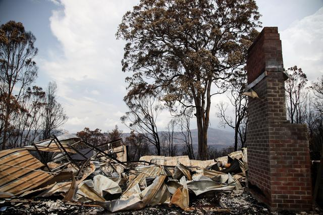 Rubble are seen at a property damaged by bushfires in Kangaroo Valley, Australia, January 20, 2020. REUTERS/Angie Teo