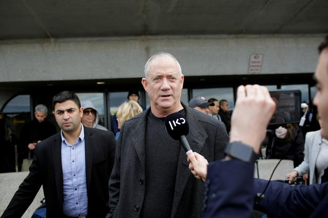 Israel's centrist party leader Benny Gantz speaks to reporters as he arrives on a flight via Zurich ahead of his meeting with U.S. President Donald Trump, at Dulles International Airport near Washington, U.S. January 26, 2020.  REUTERS/Joshua Lott