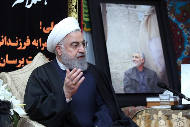 FILE PHOTO: Iranian President Hassan Rouhani visits the family of the Iranian Major-General Qassem Soleimani, head of the elite Quds Force, who was killed by an air strike in Baghdad, at his home in Tehran, Iran January 4, 2020. Official President Website/Handout via REUTERS