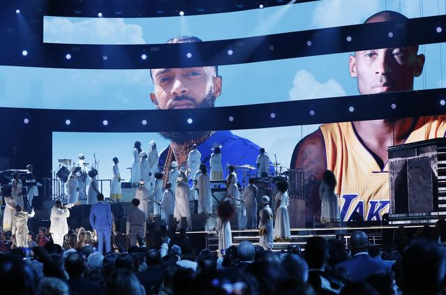 62nd Grammy Awards - Show - Los Angeles, California, U.S., January 26, 2020 - Pictures of Nipsey Hussle and Kobe Bryant are projected during a tribute. REUTERS/Mario Anzuoni
