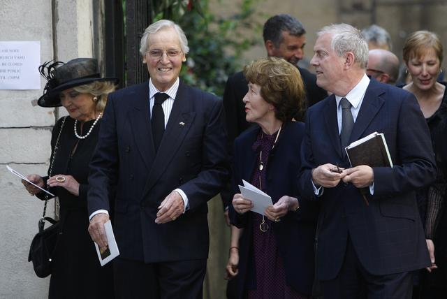 FILE PHOTO: British entertainers Nicholas Parsons (2nd L) and Gyles Brandreth (R) leave the funeral of Clement Freud at St Bride's church in London April 24, 2009.  Freud was the grandson of Sigmund Freud, and his funeral took place on Friday, which would have been his 85th birthday.      REUTERS/Andrew Winning