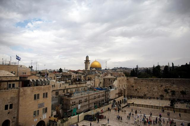 FILE PHOTO: A view of the Western Wall (R), Judaism's holiest prayer site, and the Dome of the Rock on the compound known to Muslims as Noble Sanctuary and to Jews as Temple Mount, is seen in this general view in Jerusalem's Old City October 19, 2014. REUTERS/Ronen Zvulun