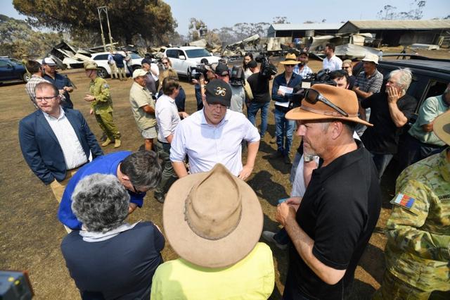 FILE PHOTO: Australian Prime Minister Scott Morrison is seen visiting a fire-damaged property on Stokes Bay on Kangaroo Island, southwest of Adelaide, Australia, January 8, 2020.   AAP Image/David Mariuz/via REUTERS