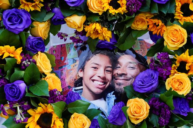 "Flowers and photos of Kobe Bryant and his daughter Gianna ""Gigi"" are placed near the Staples Center to pay tribute after a helicopter crash killed the retired basketball star and his daughter, in Los Angeles, California, U.S., January 28, 2020.  REUTERS/Kyle Grillot"