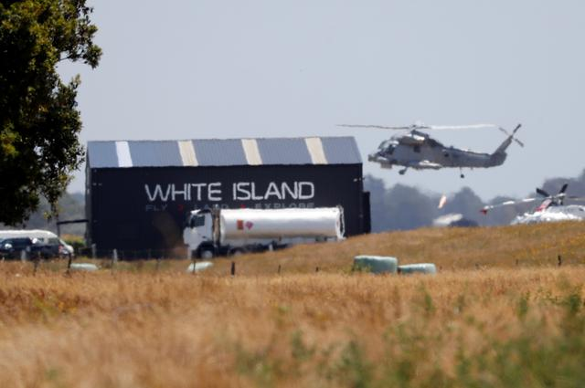 FILE PHOTO: A military helicopter flies at the airport during the rescue mission following the White Island volcano eruptions in Whakatane, New Zealand, December 13, 2019. REUTERS/Jorge Silva