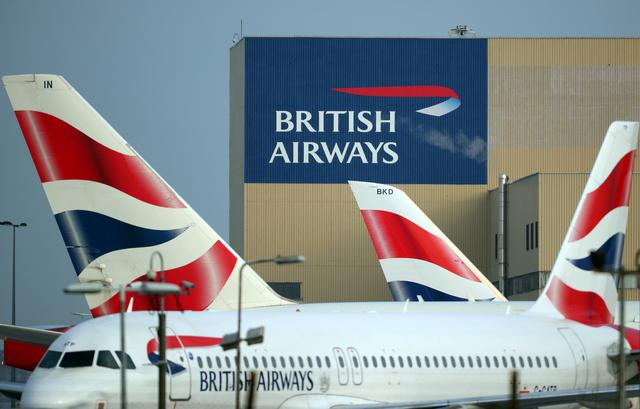 FILE PHOTO: British Airways aircraft are seen at Heathrow Airport in west London, Britain, February 23, 2018. REUTERS/Hannah McKay
