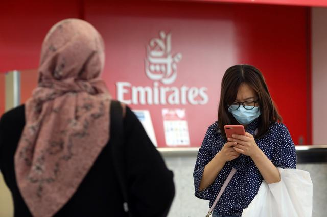 A traveller wears a mask at the Dubai International Airport, after the UAE's Ministry of Health and Community Prevention confirmed the country's first case of coronavirus, in Dubai, United Arab Emirates January 29, 2020. REUTERS/Christopher Pike