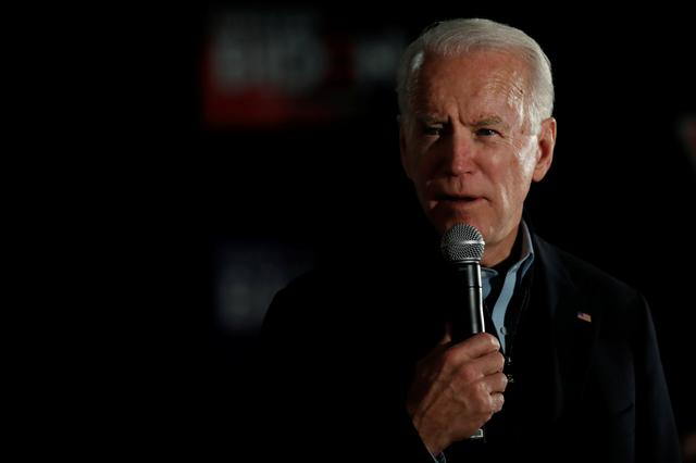FILE PHOTO: Democratic 2020 U.S. presidential candidate and former Vice President Joe Biden speaks during a campaign event in Clinton, Iowa, U.S., January 28, 2020. REUTERS/Carlos Barria