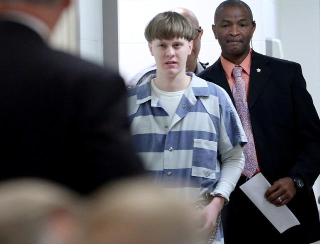 FILE PHOTO: Dylann Roof is escorted into the court room at the Charleston County Judicial Center to enter his guilty plea on murder charges in state court  for the 2015 shooting massacre at a historic black church, in Charleston, South Carolina, April 10, 2017.  REUTERS/Grace Beahm/Pool