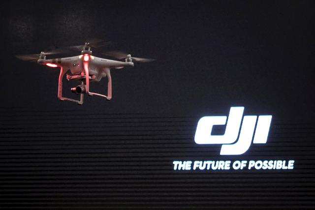 FILE PHOTO: The DJI Phantom 3, a consumer drone, takes flight after it was unveiled at a launch event in Manhattan, New York April 8, 2015.  REUTERS/Adrees Latif/File Photo