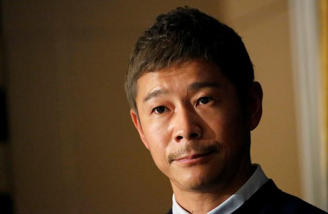 FILE PHOTO: Japanese billionaire Yusaku Maezawa, founder and chief executive of online fashion retailer Zozo, who has been chosen as the first private passenger by SpaceX, attends a news conference at the Foreign Correspondents' Club of Japan in Tokyo, Japan, October 9, 2018.   REUTERS/Toru Hanai/File Photo