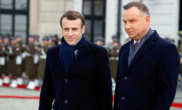 French President Emmanuel Macron and Polish President Andrzej Duda attend the welcoming ceremony in Warsaw, Poland February 3, 2020. REUTERS/Kacper Pempel