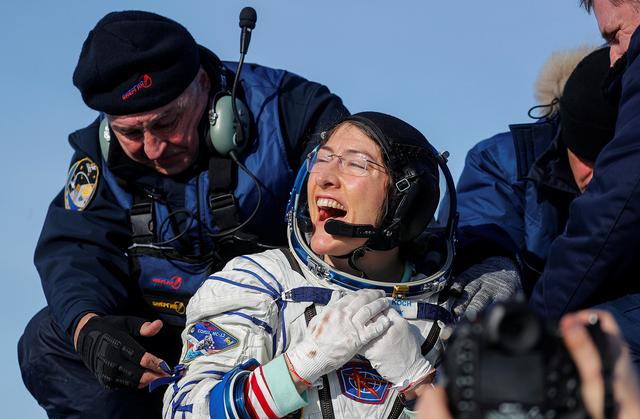NASA astronaut Christina Koch reacts shortly after landing of the Russian Soyuz MS-13 space capsule in a remote area southeast of Zhezkazgan in the Karaganda region of Kazakhstan, February 6, 2020.  Sergei Ilnitsky/Pool via REUTERS