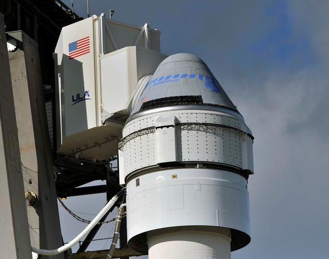 FILE PHOTO: The Boeing CST-100 Starliner spacecraft, atop a ULA Atlas V rocket, stands at launch complex 40 at the Cape Canaveral Air Force Station in Cape Canaveral, Florida December 19, 2019. REUTERS/Steve Nesius/File Photo