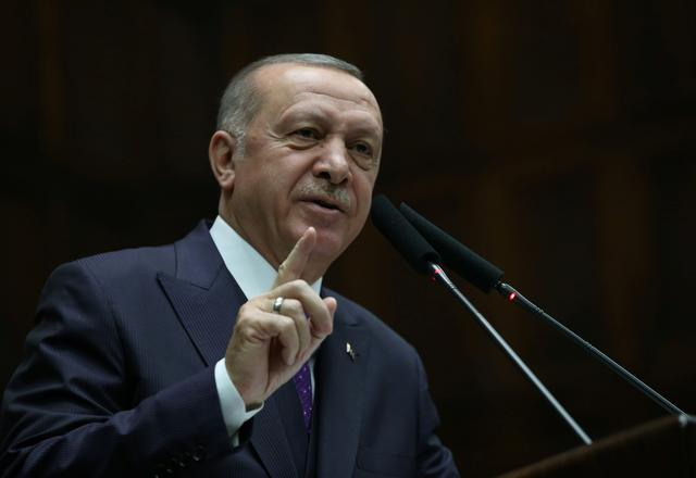 FILE PHOTO: Turkish President Tayyip Erdogan addresses members of his ruling AK Party during a meeting at the Parliament in Ankara, Turkey, February 5, 2020. Presidential Press Office/Handout via REUTERS