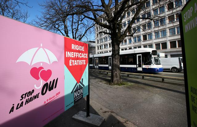 """FILE PHOTO: A poster in favour of the change of the penal code is pictured ahead of a referendum on anti-homophobia law in Geneva, Switzerland, February 6, 2020.  The poster reads : """"Stop the hatred, yes"""". Picture taken February 6, 2020. REUTERS/Denis Balibouse/File Photo"""