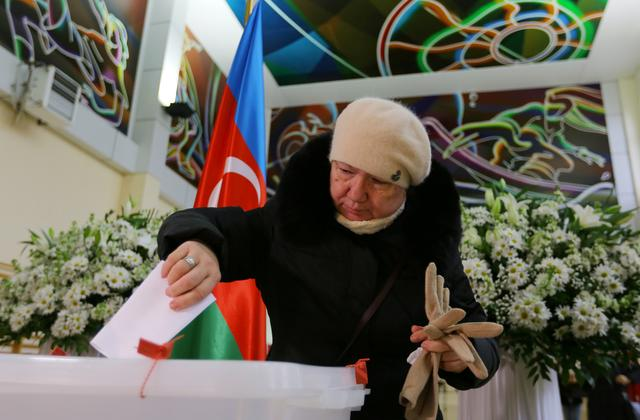 A woman casts her vote at a polling station during a snap parliamentary election in Baku, Azerbaijan February 9, 2020. REUTERS/Aziz Karimov