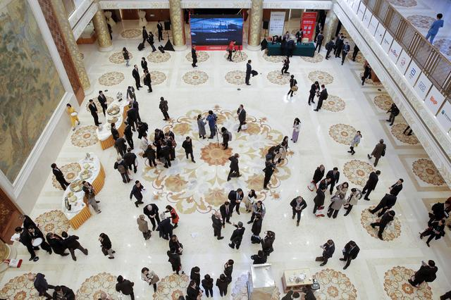 FILE PHOTO: People attend the China Development Forum in Beijing, China, March 23, 2019. REUTERS/Thomas Peter