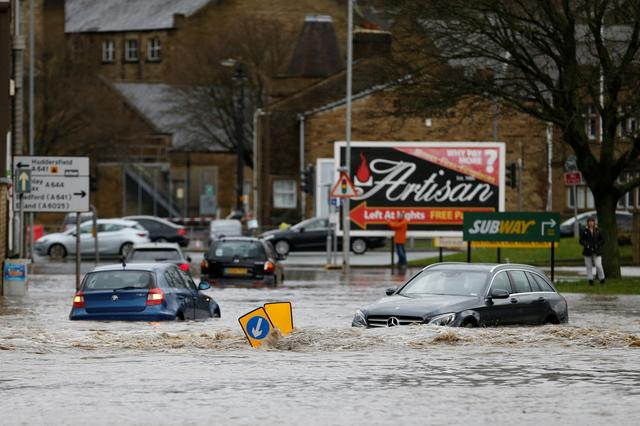Cars sit in floodwater in Brighouse, West Yorkshire, Britain February 9, 2020. REUTERS/Ed Sykes