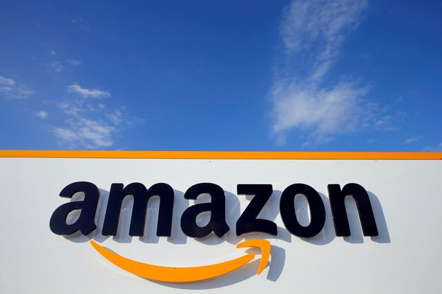 FILE PHOTO: The logo of Amazon is seen at the company logistics centre in Boves, France, August 8, 2018. REUTERS/Pascal Rossignol