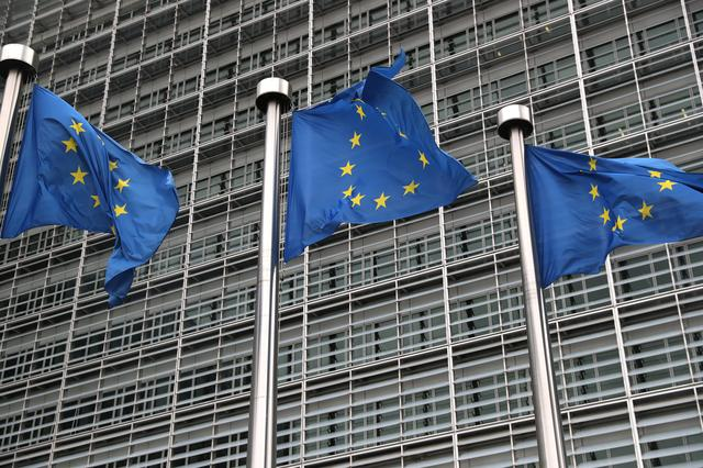 FILE PHOTO: European Union flags fly outside the European Commission headquarters in Brussels, Belgium, October 4, 2019. REUTERS/Yves Herman/File Photo