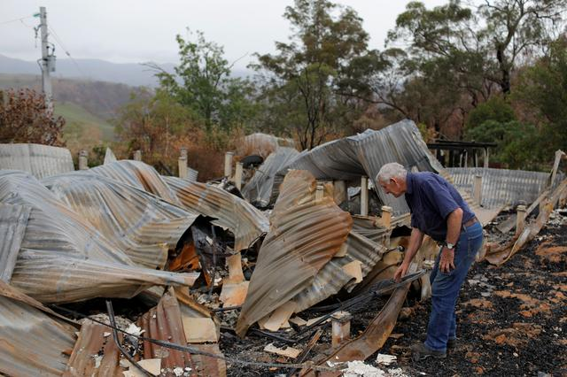 Farmer Jeff McCole, 70, looks through the remains of his family home destroyed by bushfire during an interview with Reuters in Buchan, Victoria, Australia, January 23, 2020. REUTERS/Andrew Kelly