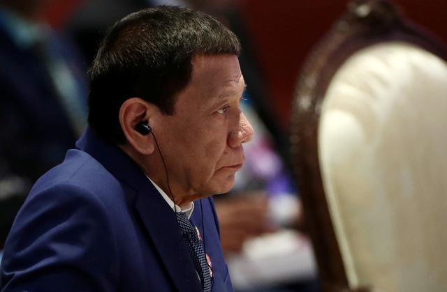 FILE PHOTO: Philippine President Rodrigo Duterte attends a plenary session at a regional summit in Bangkok, Thailand November 2, 2019. REUTERS/Athit Perawongmetha