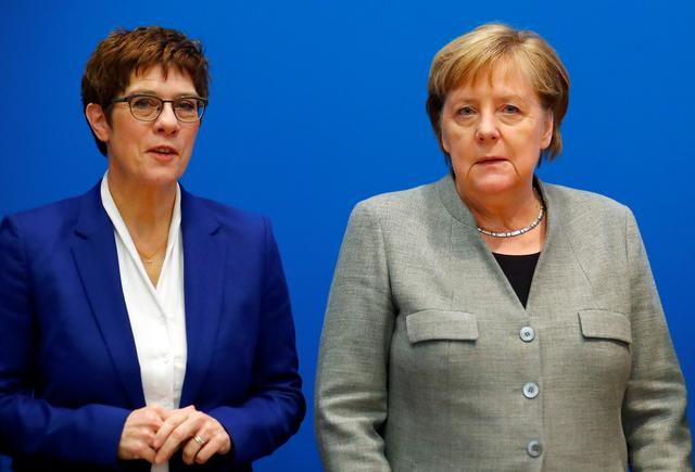 FILE PHOTO: Outgoing leader of the Christian Democratic Union (CDU) Annegret Kramp-Karrenbauer and Germany's Chancellor Angela Merkel arrive for a board meeting at the party's headquarters in Berlin, Germany February 10, 2020. REUTERS/Hannibal Hanschke
