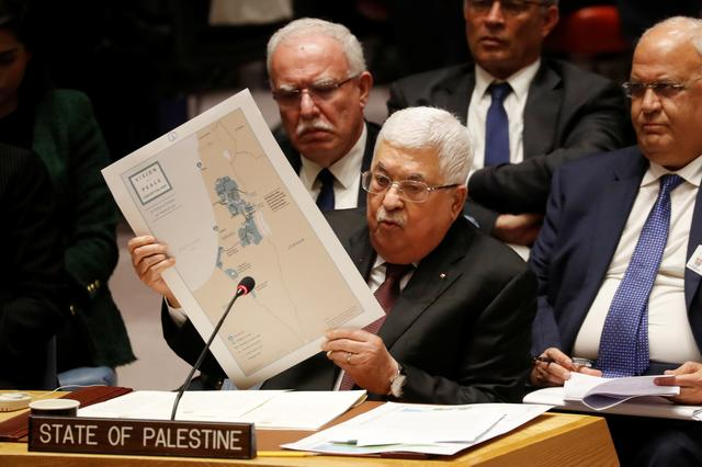 Palestinian President Mahmoud Abbas holds a map while speaking during a Security Council meeting at the United Nations in New York, U.S., February 11, 2020.  REUTERS/Shannon Stapleton