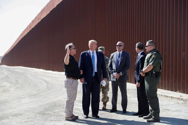 FILE PHOTO: U.S. President Donald Trump visits a section of the U.S.-Mexico border wall in Otay Mesa, California, U.S. September 18, 2019. REUTERS/Tom Brenner/File Photo