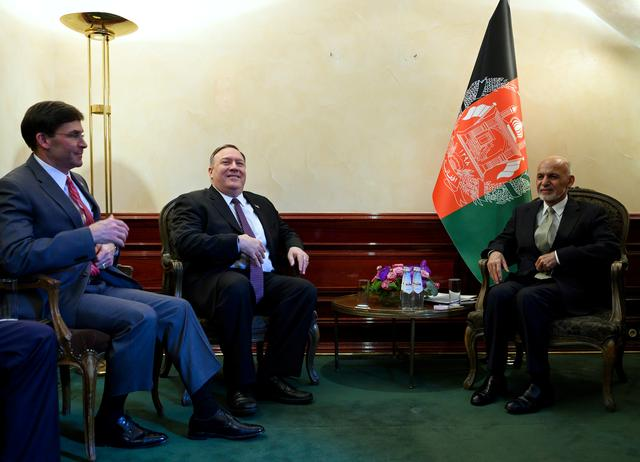 U.S. Secretary of State Mike Pompeo (2nd L), together with U.S. Secretary of Defense Mark Esper (L), meets with Afghan President Ashraf Ghani during the Munich Security conference in Munich, southern Germany February 14, 2020. Andrew Caballero-Reynolds/Pool via REUTERS