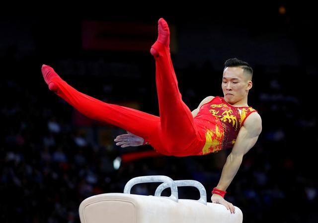 FILE PHOTO: Artistic Gymnastics - 2019 World Artistic Gymnastics Championships - Men's Team Final - Pommel Horse - Hanns-Martin-Schleyer-Halle, Stuttgart, Germany - October 9, 2019   China's Xiao Ruoteng in action    REUTERS/Wolfgang Rattay/File Photo