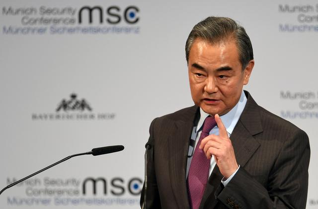 Chinese Foreign Minister Wang Yi gestures as he speaks at the annual Munich Security Conference in Germany February 15, 2020. REUTERS/Andreas Gebert