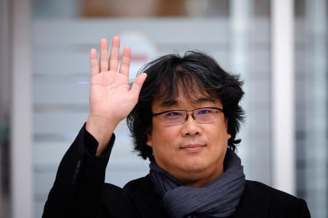 Director of four Oscar award-winning film 'Parasite' Bong Joon-ho poses for photographs upon his arrival at Incheon International Airport in Incheon, South Korea, February 16, 2020.  REUTERS/Kim Hong-Ji
