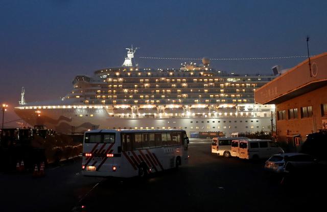A bus arrives at the cruise ship Diamond Princess, where dozens of passengers were tested positive for coronavirus, at Daikoku Pier Cruise Terminal in Yokohama, south of Tokyo, Japan, February 16, 2020. REUTERS/Issei Kato