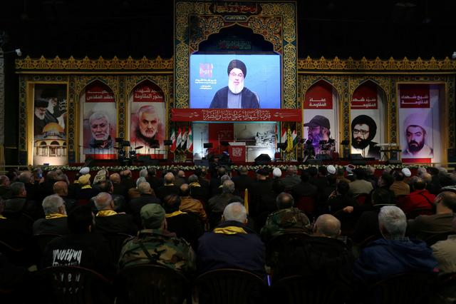 FILE PHOTO: Lebanon's Hezbollah leader Sayyed Hassan Nasrallah addresses his supporters through a screen during a rally commemorating the annual Hezbollah's slain leaders in Beirut's southern suburbs, Lebanon February 16, 2020. REUTERS/Aziz Taher
