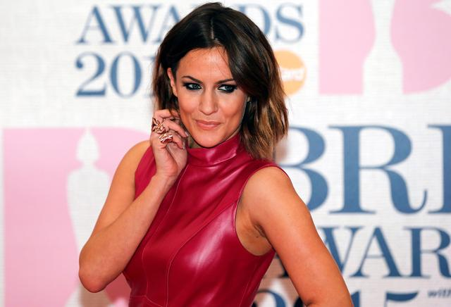 FILE PHOTO: Television presenter Caroline Flack arrives for the BRIT music awards at the O2 Arena in Greenwich, London, February 25, 2015. REUTERS/Suzanne Plunkett
