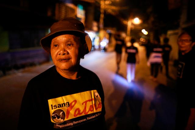 FILE PHOTO: Maria Oqueria, 64, a member of a volunteer group of women patrollers, is photographed while on duty in Pateros, Metro Manila, Philippines, January 27, 2020. REUTERS/Eloisa Lopez