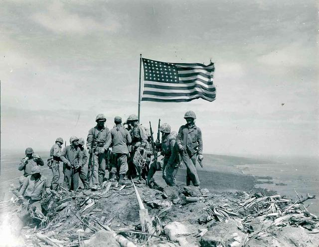 U.S. Marines raise the American flag atop Mount Suribachi on Iwo Jima, 1945.  Courtesy U.S. National Archives/U.S. Marine Corps Photograph/Private Bob Campbell/Handout via REUTERS