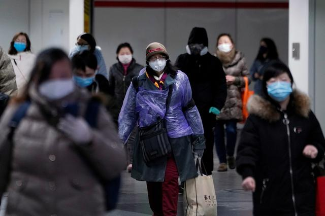 People wearing face masks walk inside a subway station, as the country is hit by an outbreak of the novel coronavirus, in Shanghai, China February 17, 2020.  REUTERS/Aly Song